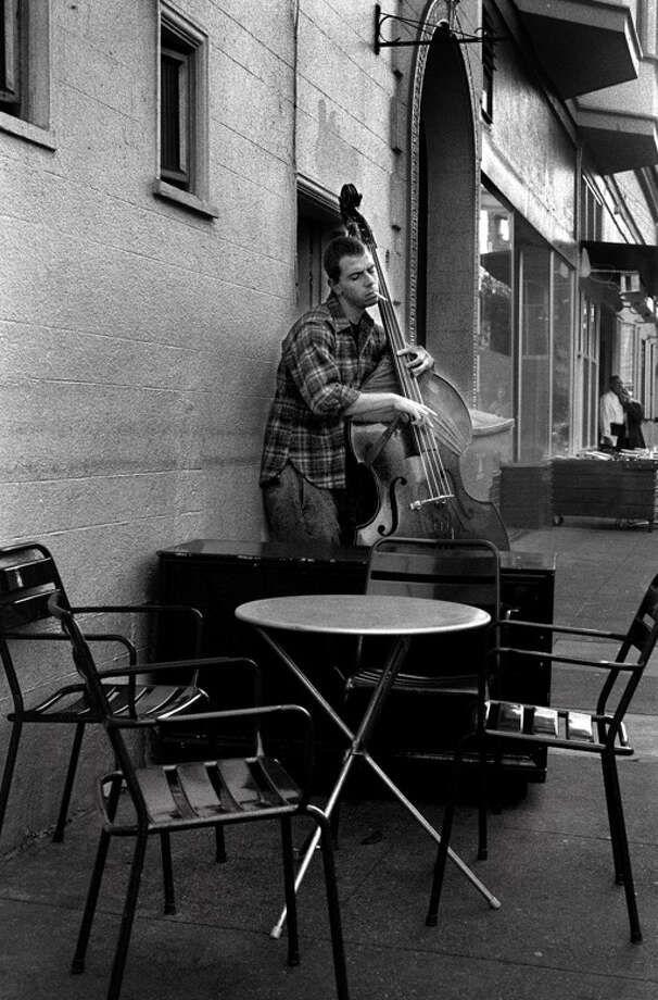 A musician has a smoke and a song in the Mission district. (Photo by Russel Yip/The Chronicle) Photo: Russell Yip, The Chronicle / sfc