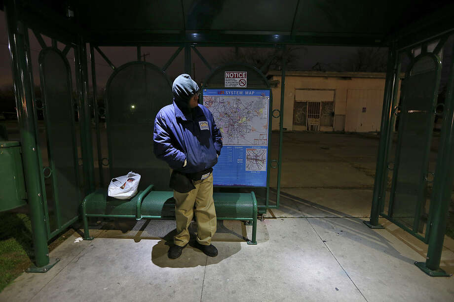 Armando Hernandez waits for the bus along Old Highway 90 on Tuesday, Jan. 28, 2014. Temperatures are in the low 30's with wind chill factors in the high 20's. Schools throughout the area remain open. Hernandez was on his way to work. Photo: Jerry Lara, San Antonio Express-News / ©2013 San Antonio Express-News