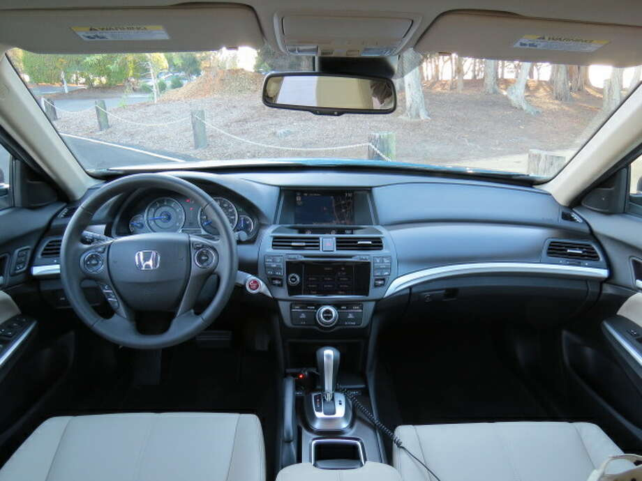 The interior is typically Honda – everything in its place, nearly everything intuitive, conservative instruments and, overall, no surprises. The car has all the requisite safety features, including electronic stability control, lane departure warning, airbags and air curtains galore, and a feeling that it is a solid, heavy (about two tons) vehicle that will do its best to get you out of scrapes.