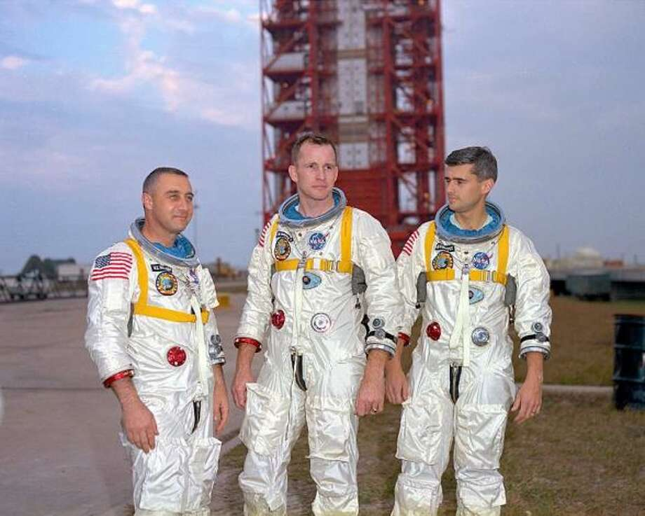 Apollo 1 Astronauts (from left) Gus Grissom, Ed White and Roger Chaffee pose in front of Launch Complex 34, which housed their Saturn 1 launch vehicle, on Jan. 17, 1967. The astronauts died in a fire on the pad 10 days later.