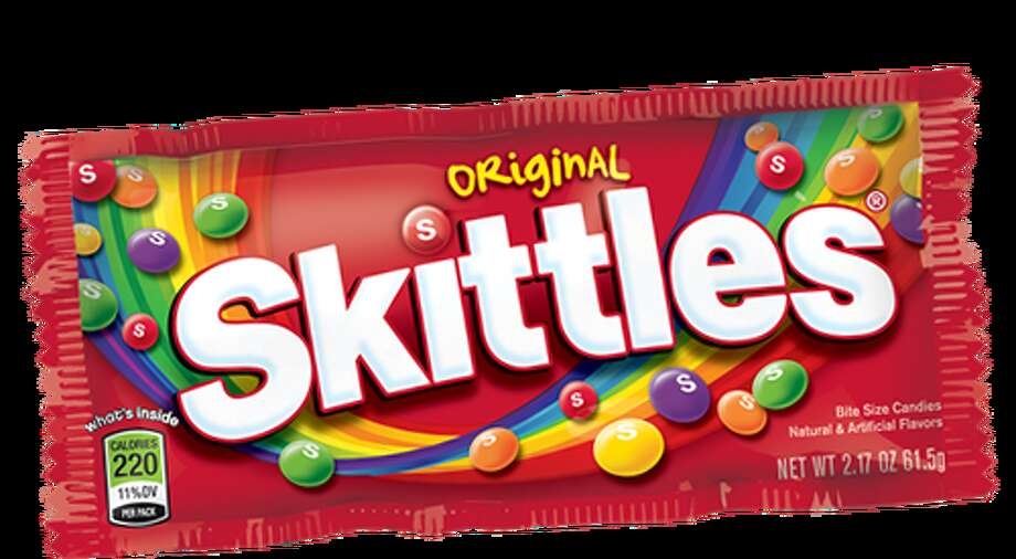 """Recent """"Taste the rainbow"""" commercials by Skittles have taken a creepy turn with random people's smiles made of candy instead of teeth, but the slogan is still catchy."""