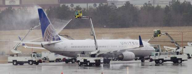 A United jet is sprayed down with de-icing chemicals before takeoff at George Bush Intercontinental Airport Tuesday, Jan. 28, 2014, in Houston. ( Brett Coomer / Houston Chronicle ) Photo: Brett Coomer, Houston Chronicle