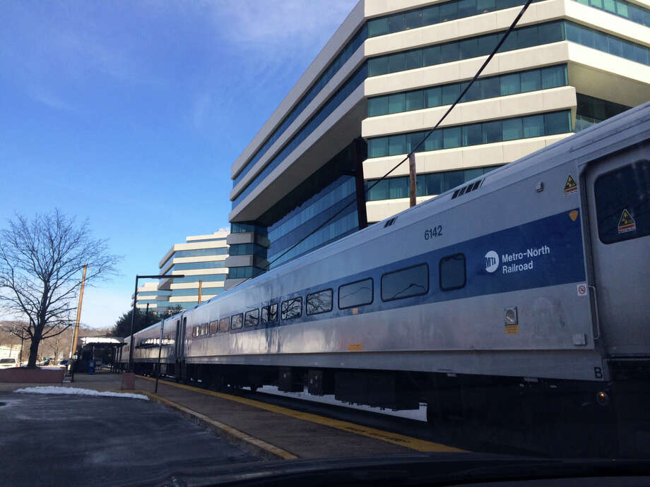 A train sits on the tracks at the  Merritt 7 Metro-North railroad station in Norwalk, Conn. on Tuesday, Jan. 28, 2014. Photo: Lindsay Perry / Stamford Advocate