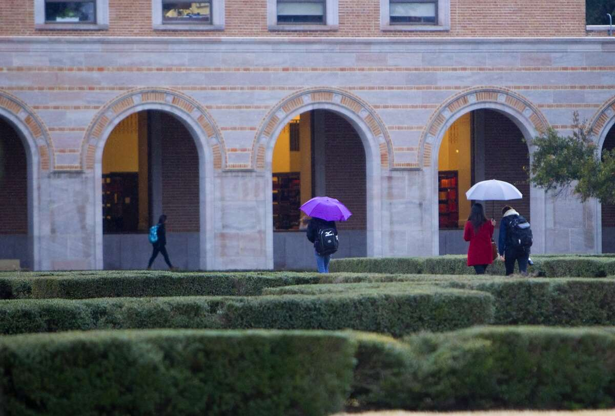 Rice University students and personnel carry on to classes Tuesday, Jan. 28, 2014, in Houston. Despite the majority of Houston being shutdown, Rice is continuing classes. (Cody Duty / Houston Chronicle)