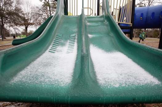 Sleet accumulates on the playground slides at Meyer Park   Tuesday, Jan. 28, in Spring.   (Melissa Phillip / Houston Chronicle)