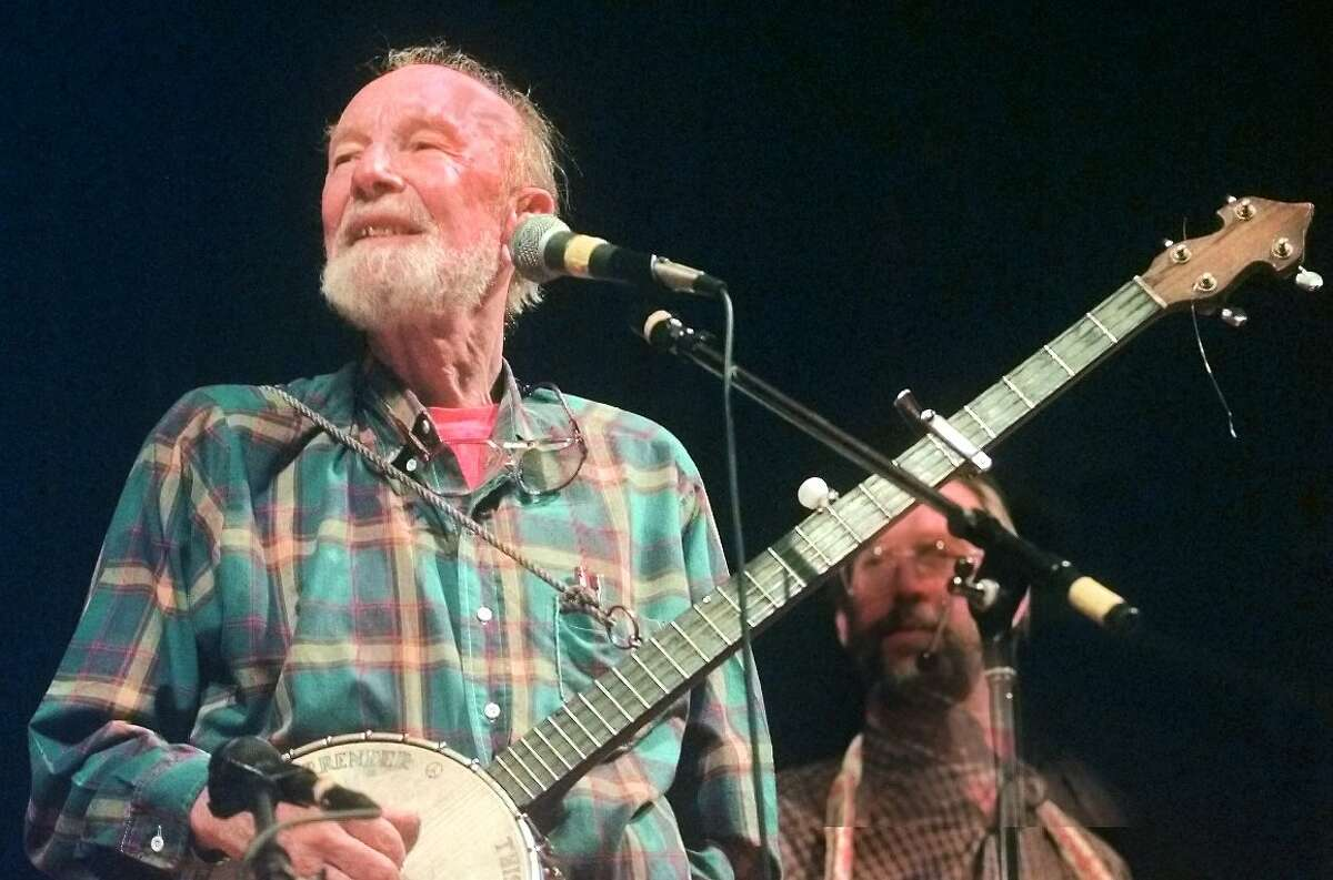 Times Union Staff Photo by JAMES GOOLSBY-OCT. 3, 1998-Pete Seeger, world famous folk singer, performs at Page Hall at the University at Albany.