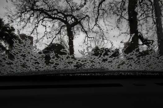Ice pellets accumulate on the windshield of a car at Hermann Park on Tuesday. (James Nielsen/Houston Chronicle)
