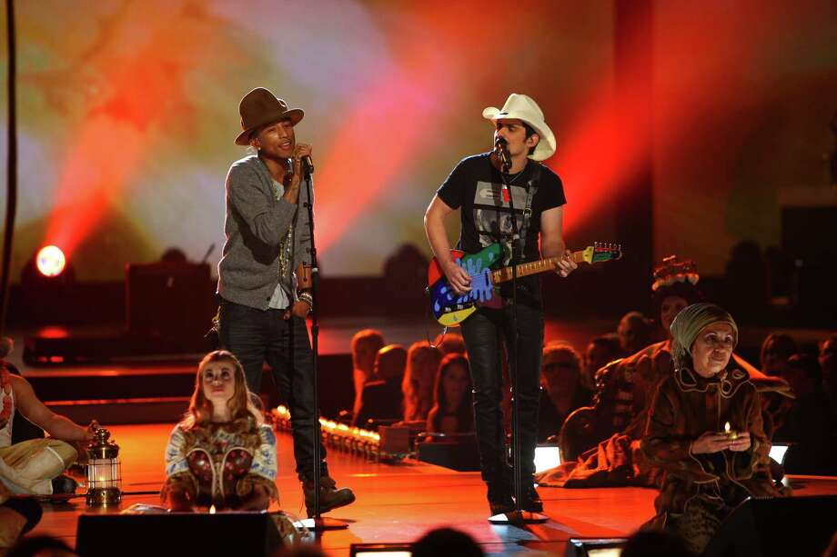 "Pharrell Williams, Brad Paisley and Cique ""LOVE"" perform at The Night that Changed America: A Grammy Salute to the Beatles, on Monday, Jan. 27, 2014, in Los Angeles. (Photo by Zach Cordner/Invision/AP) ORG XMIT: CAZC163 Photo: Zach Cordner, AP / Invision"