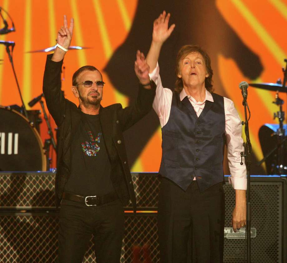 Ringo Starr and Paul McCartney perform at The Night that Changed America: A Grammy Salute to the Beatles, on Monday, Jan. 27, 2014, in Los Angeles. (Photo by Zach Cordner/Invision/AP) ORG XMIT: CAZC125 Photo: Zach Cordner, AP / Invision
