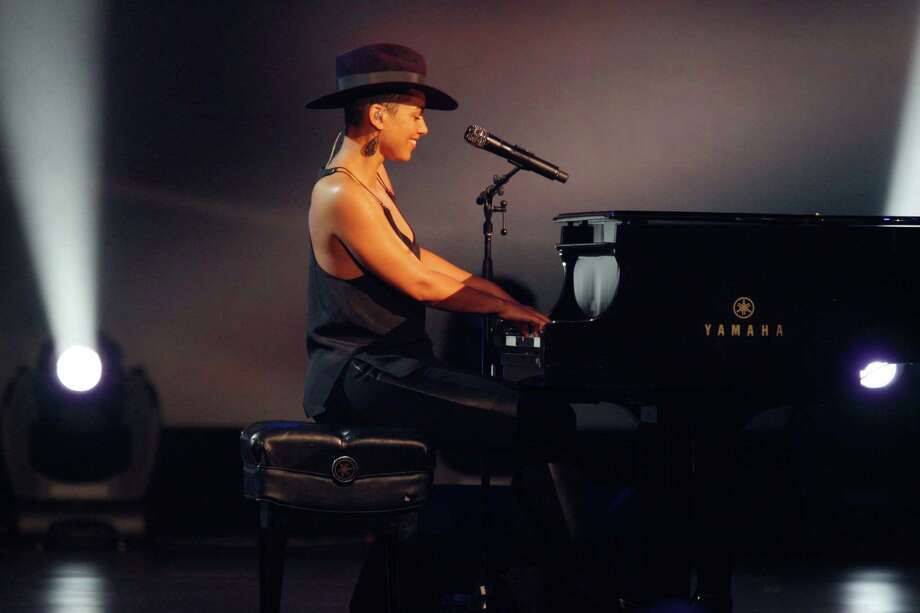 Alicia Keys performs at the night that changed America: a Grammy salute to the Beatles, on Monday, Jan. 27, 2014, in Los Angeles. (Photo by Zach Cordner/Invision/AP) ORG XMIT: CABR101 Photo: Zach Cordner, AP / Invision