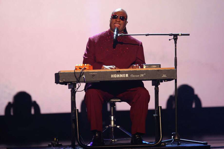 Stevie Wonder performs at The Night that Changed America: a Grammy Salute to the Beatles, on Monday, Jan. 27, 2014, in Los Angeles. (Photo by Zach Cordner/Invision/AP) ORG XMIT: CAZC107 Photo: Zach Cordner, AP / Invision