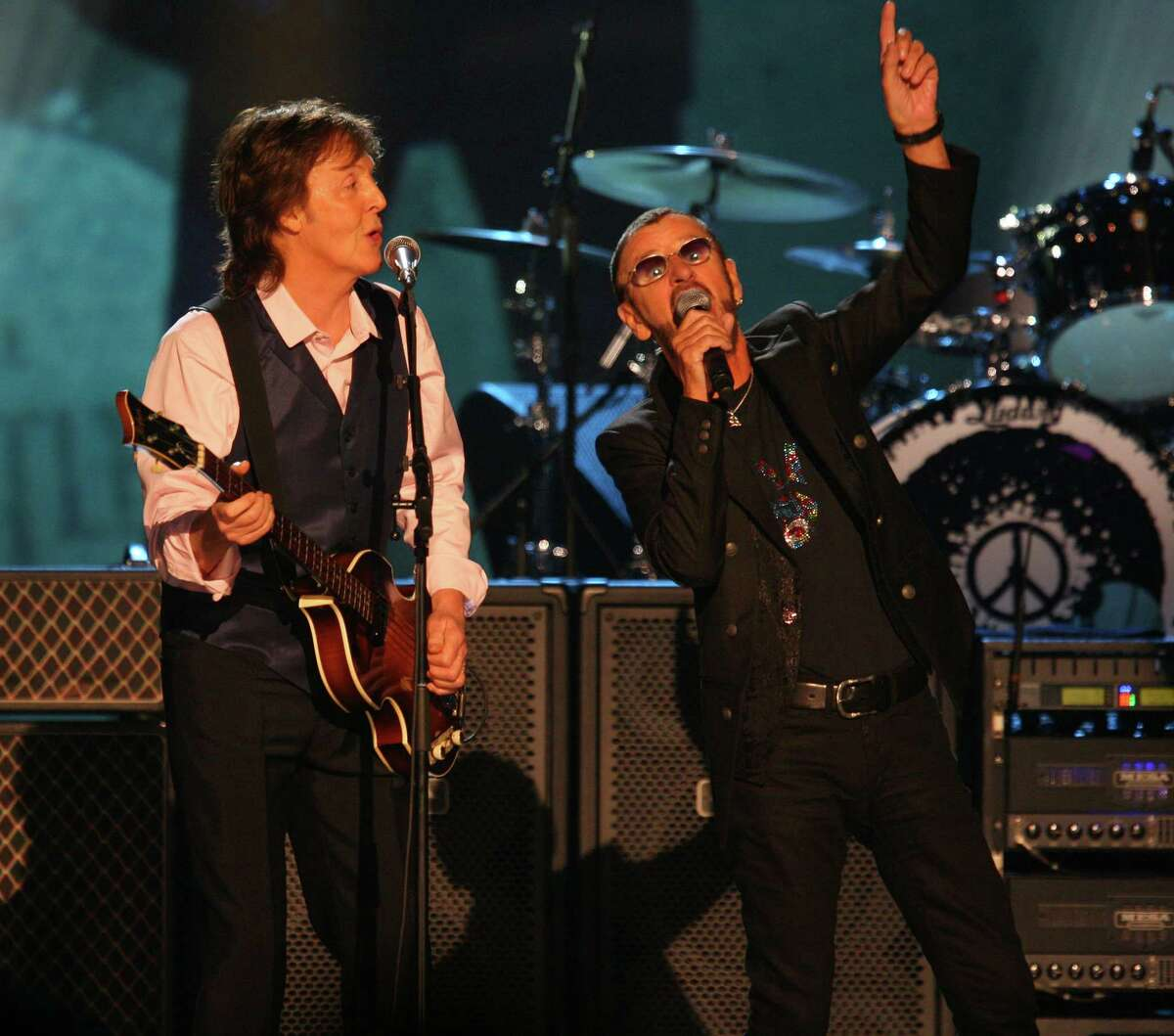 Paul McCartney and Ringo Starr perform at The Night that Changed America: A Grammy Salute to the Beatles, on Monday, Jan. 27, 2014, in Los Angeles. (Photo by Zach Cordner/Invision/AP) ORG XMIT: CAZC103