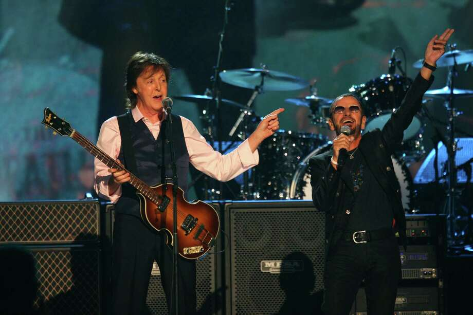 Paul McCartney and Ringo Starr perform at The Night that Changed America: A Grammy Salute to the Beatles, on Monday, Jan. 27, 2014, in Los Angeles. (Photo by Zach Cordner/Invision/AP) ORG XMIT: CAZC110 Photo: Zach Cordner, AP / Invision
