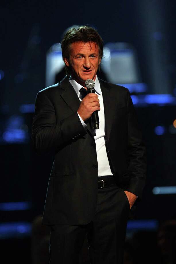Sean Penn introduces Paul McCartney at The Night That Changed America: A Grammy Salute to the Beatles, on Monday, Jan. 27, 2014, in Los Angeles. (Photo by Zach Cordner/Invision/AP) ORG XMIT: CAZC119 Photo: Zach Cordner, AP / Invision