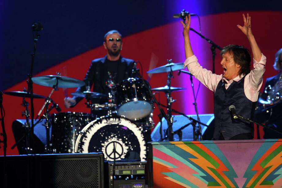 Paul McCartney and Ringo Starr perform at The Night that Changed America: A Grammy Salute to the Beatles, on Monday, Jan. 27, 2014, in Los Angeles. (Photo by Zach Cordner/Invision/AP) ORG XMIT: CAZC124 Photo: Zach Cordner, AP / Invision