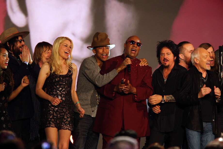 Pharrell Williams and Stevie Wonder perform at The Night that Changed America: A Grammy Salute to the Beatles, on Monday, Jan. 27, 2014, in Los Angeles. (Photo by Zach Cordner/Invision/AP) ORG XMIT: CAZC133 Photo: Zach Cordner, AP / Invision