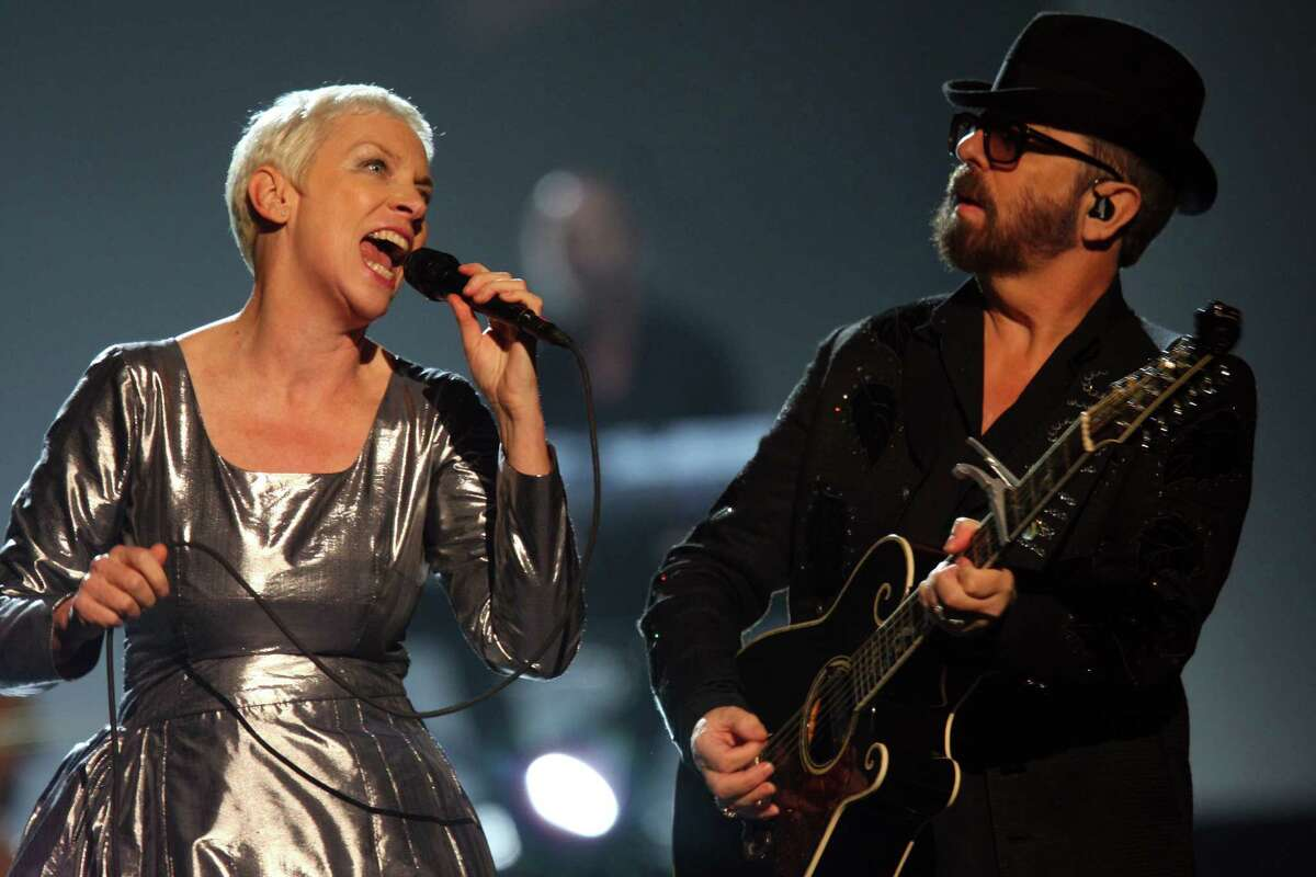 Annie Lennox and Dave Stewart of the Eurythmics perform at The Night that Changed America: A Grammy Salute to the Beatles, on Monday, Jan. 27, 2014, in Los Angeles. (Photo by Zach Cordner/Invision/AP) ORG XMIT: CAZC142