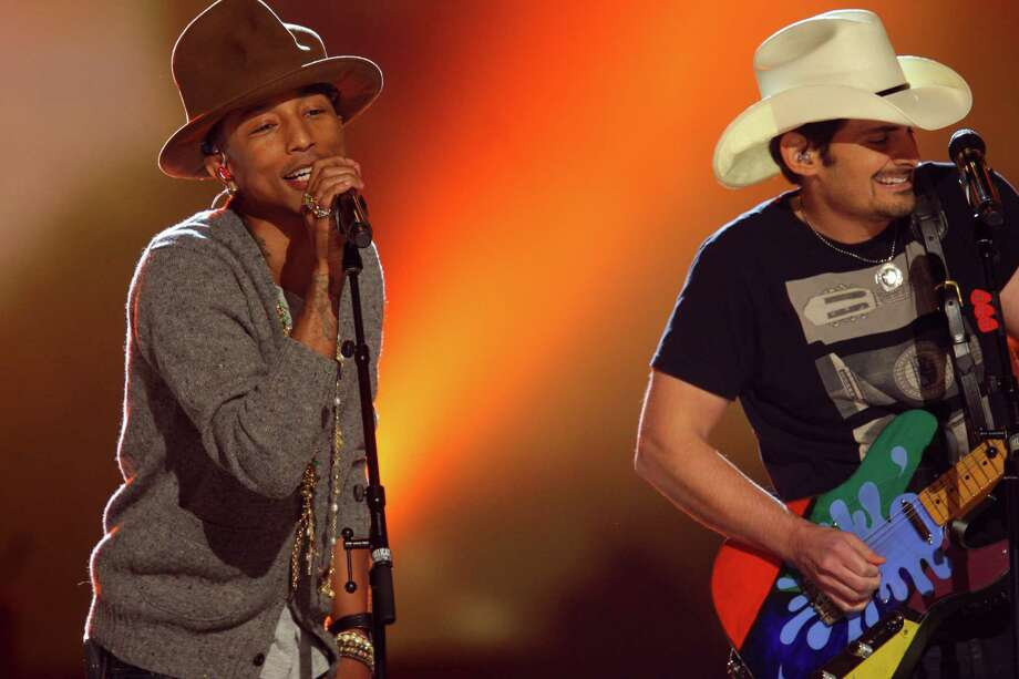 Pharrell Williams and Brad Paisley perform at The Night that Changed America: A Grammy Salute to the Beatles, on Monday, Jan. 27, 2014, in Los Angeles. (Photo by Zach Cordner/Invision/AP) ORG XMIT: CAZC153 Photo: Zach Cordner, AP / Invision