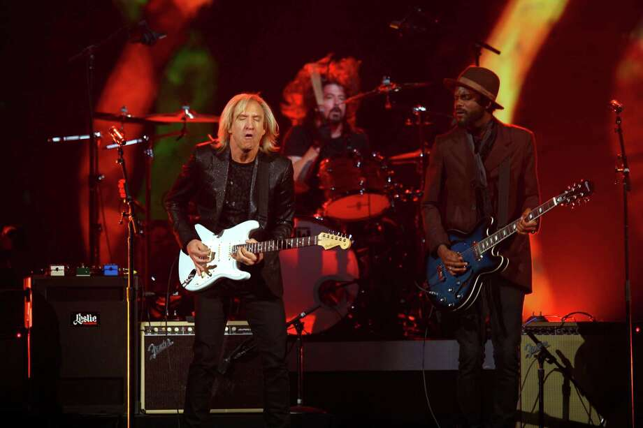Joe Walsh, Dave Grohl and Gary Clark Jr. perform at The Night that Changed America: A Grammy Salute to the Beatles, on Monday, Jan. 27, 2014, in Los Angeles. (Photo by Zach Cordner/Invision/AP) ORG XMIT: CAZC164 Photo: Zach Cordner, AP / Invision
