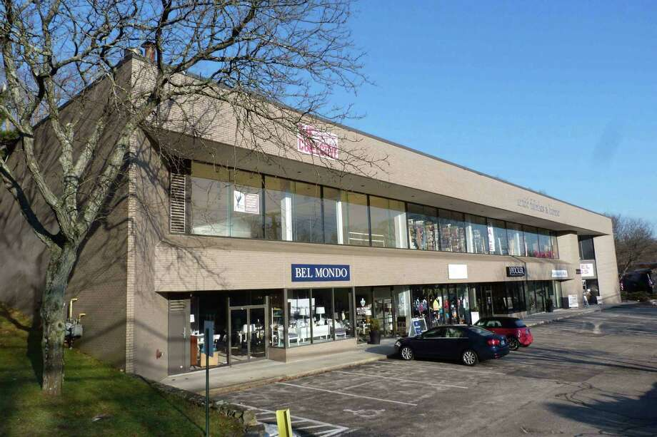 This two-story retail building at 222 Post Road West has been sold to an out-of-state investment firm for $5.75 million. The property houses the Bel Mondo interior design and Pompanoosuc Mills furniture stores, plus five other tenants. Photo: Contributed Photo / Westport News