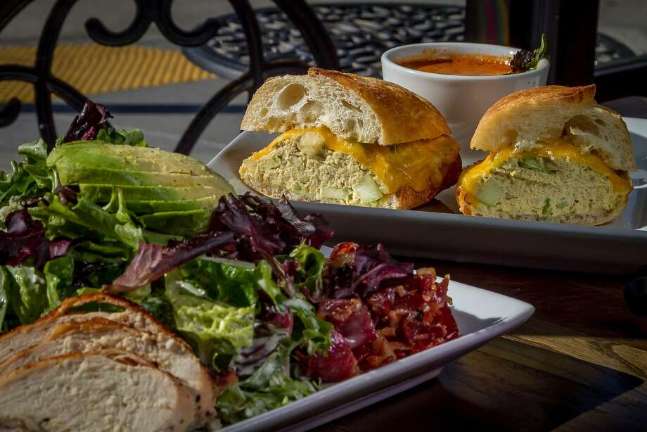 Clockwise, from left: The Gaslamp Cafe in San Francisco offers homey bistro fare, such as an entree-size Cobb salad (left) and tuna melt with the tomato basil soup, and a decadent brioche breakfast sandwich. Photo: John Storey, Special To The Chronicle
