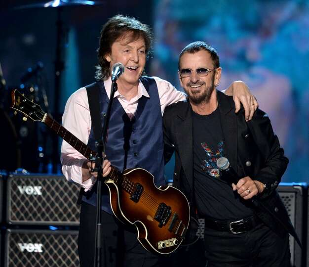 Recording artists Paul McCartney (L) and Ringo Starr perform onstage during