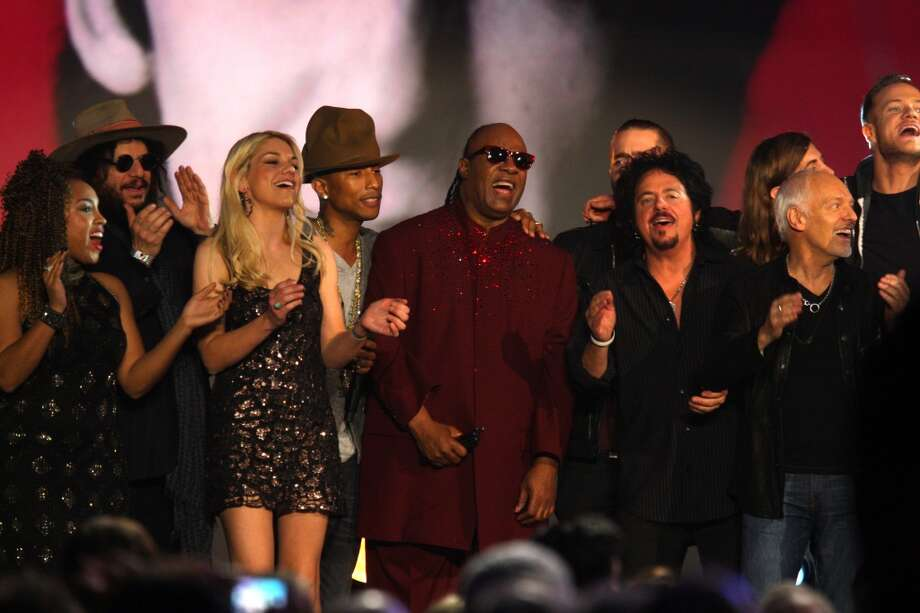 Pharrell Williams, fourth from left, and Stevie Wonder, center, perform at The Night that Changed America: A Grammy Salute to the Beatles, on Monday, Jan. 27, 2014, in Los Angeles. Photo: Zach Cordner, Associated Press