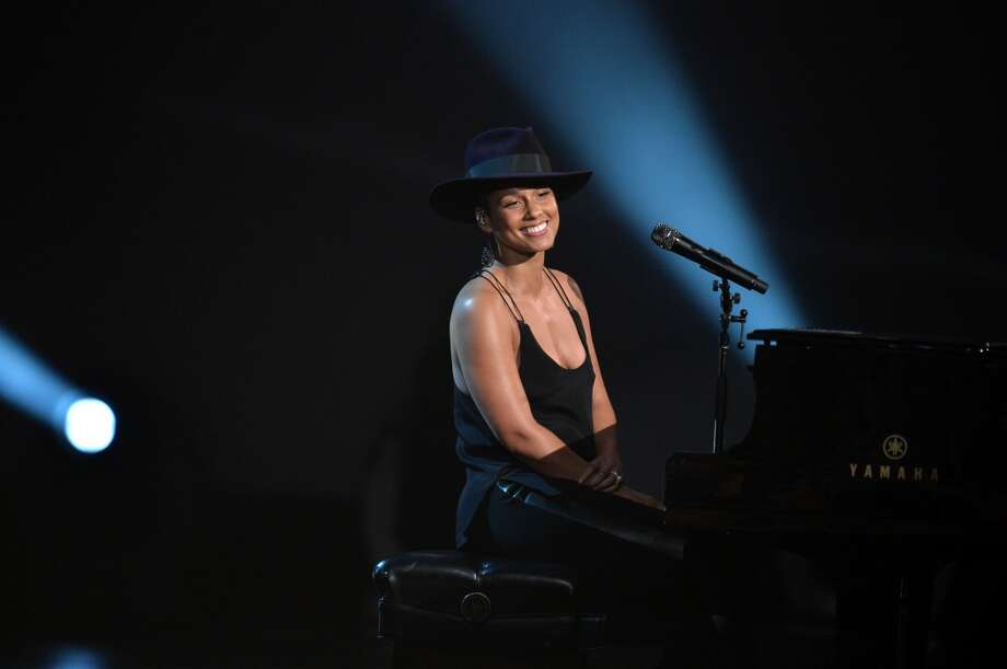 """Recording artist Alicia Keys performs onstage during """"The Night That Changed America: A GRAMMY Salute To The Beatles"""" at the Los Angeles Convention Center on January 27, 2014 in Los Angeles, California. Photo: Kevin Winter, Getty Images For NARAS"""