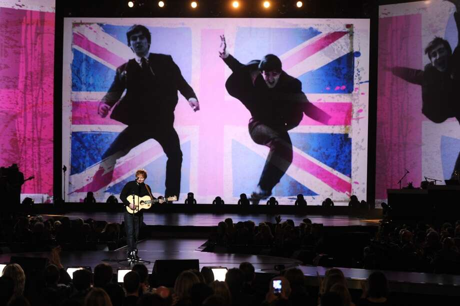 "Recording artist Ed Sheeran performs onstage during ""The Night That Changed America: A GRAMMY Salute To The Beatles"" at the Los Angeles Convention Center on January 27, 2014 in Los Angeles, California. Photo: Kevin Winter, Getty Images For NARAS"