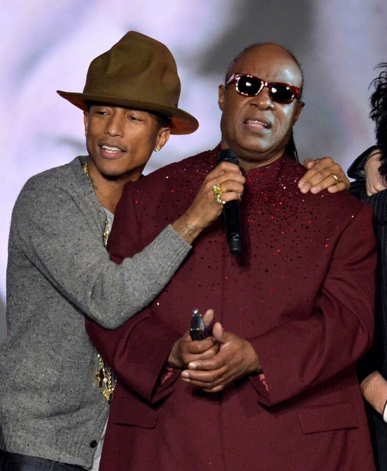 "Recording artists Pharrell Williams (L) and Stevie Wonder perform onstage during ""The Night That Changed America: A GRAMMY Salute To The Beatles"" at the Los Angeles Convention Center on January 27, 2014 in Los Angeles, California. Photo: Kevin Winter, Getty Images"