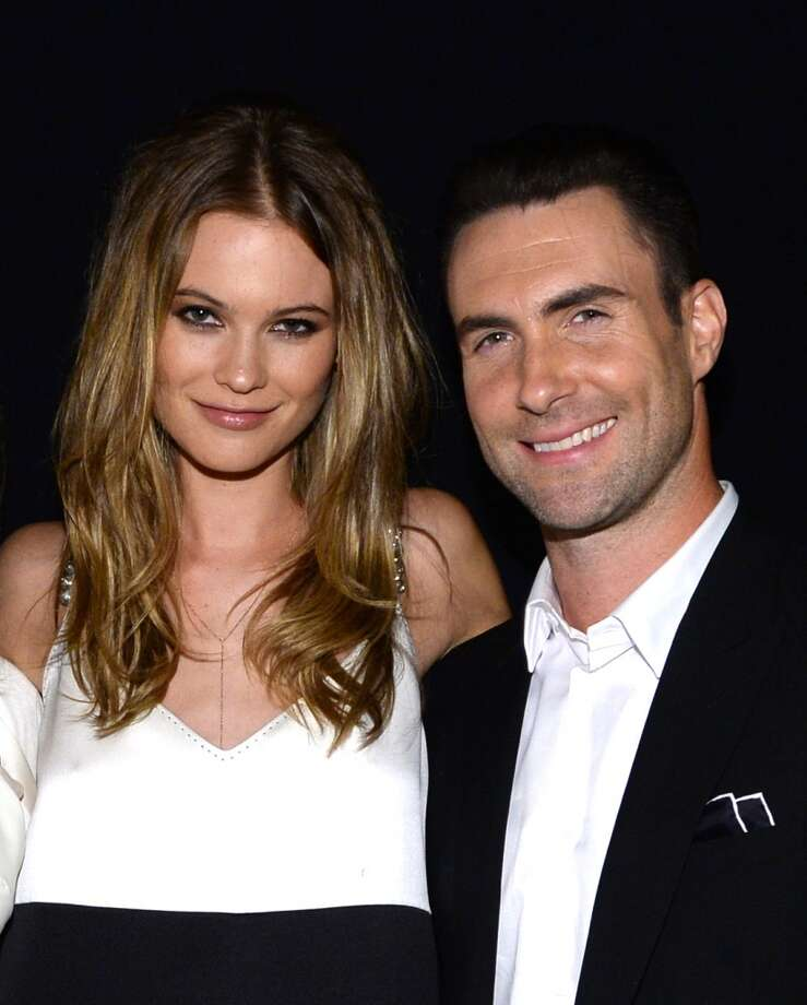 "(L-R) Mdel Behati Prinsloo and recording artist Adam Levine of Maroon 5 attend ""The Night That Changed America: A GRAMMY Salute To The Beatles"" at the Los Angeles Convention Center on January 27, 2014 in Los Angeles, California. Photo: Larry Busacca, Getty Images For NARAS"