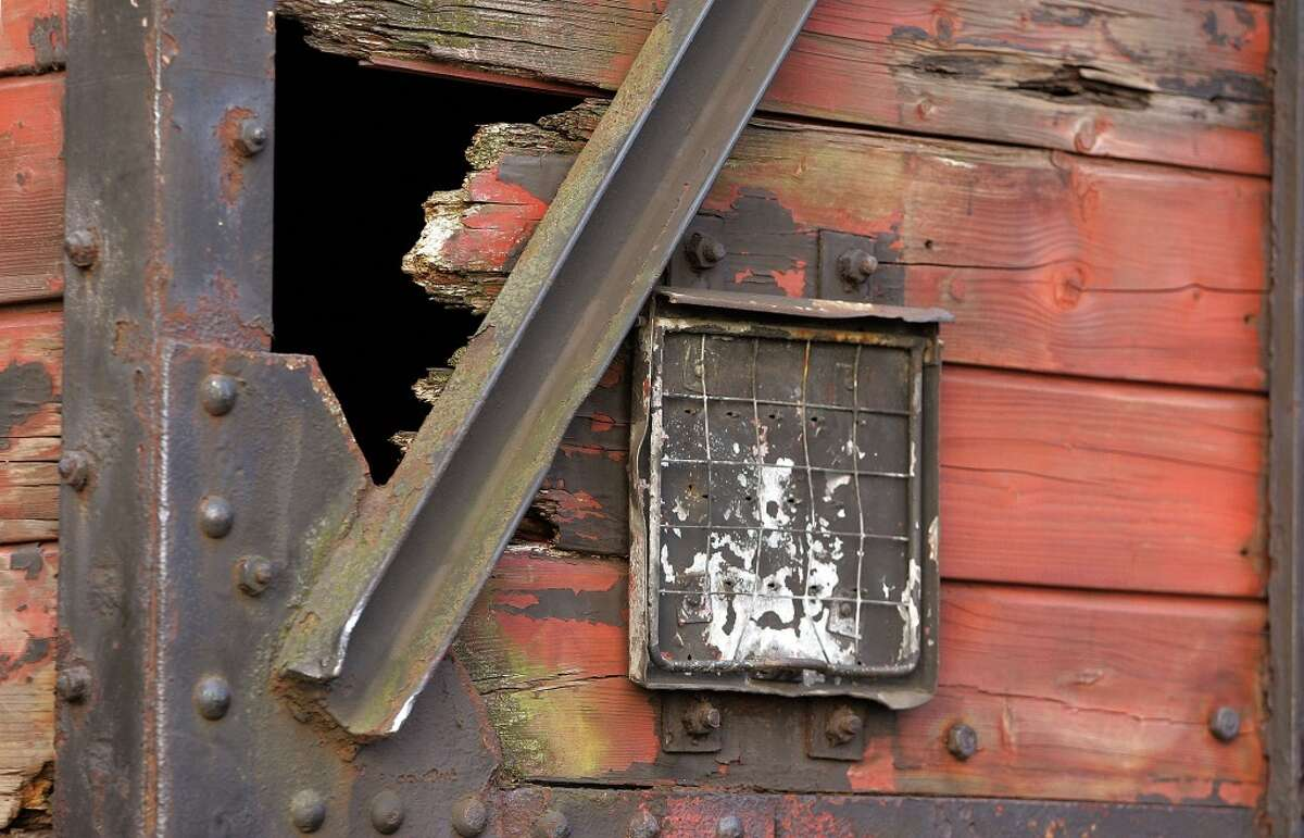 A small hole in the wooden structure of what is believed to be a German boxcar used during the Holocaust is seen during its unveiling November 9, 2005 in downtown Chicago, Illinois. The boxcar unveiling was part of a program for the 57th anniversary of Kristallnacht and will be a cornerstone for a new Holocaust museum to be built in Skokie, Illinois. Nov. 2020 marks 82 years since the mass destruction and arrest of thousands of Jews in Germany and Austria. (Photo by Tim Boyle/Getty Images)