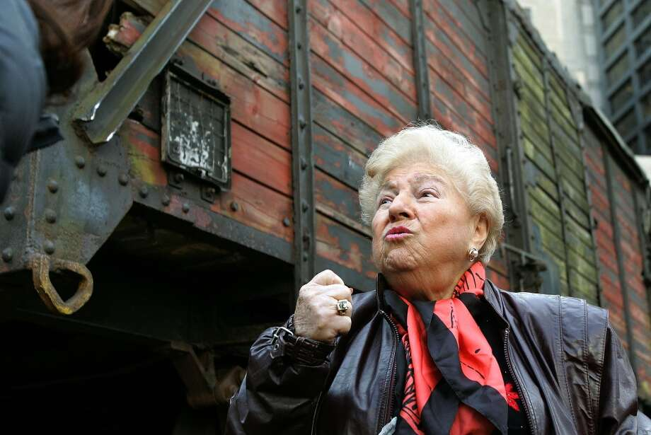 Holocaust survivor Barbara Steiner, from Skokie, Illinois speaks to the media in front of what is believed to be a German boxcar used during the Holocaust November 9, 2005 in Chicago, Illinois. Steiner at the age of 16, was transported in a boxcar similar to this one to the Majdanek extermination camp in Poland. Steiner lost her parents and two brothers in the Holocaust. The boxcar unveiling was part of a program for the 57th anniversary of Kristallnacht and will be a cornerstone for a new Holocaust museum to be built in Skokie, Illinois. (Photo by Tim Boyle/Getty Images) Photo: Tim Boyle, Getty Images