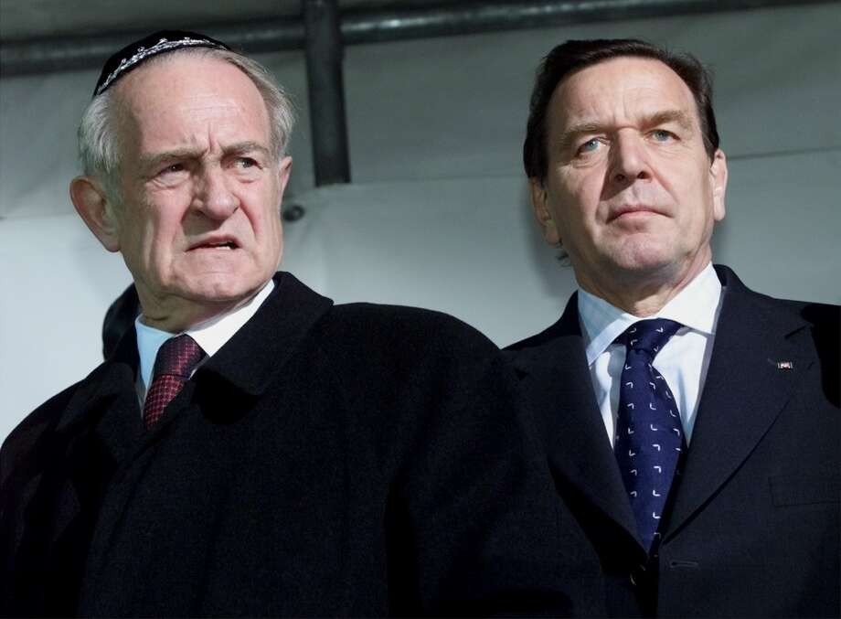 German President Johannes Rau, left, and Chancellor Gerhard Schroeder attend a protest march against hate and anti-foreigner violence in Berlin, Thursday, Nov. 9, 2000.  Leading German political figures and personalities marched from a prewar Berlin synagogue to the Brandenburg Gate in a march commemorating the Nov. 9, 1938, Kristallnacht pogrom, also known as the 'Night of Broken Glass.' (AP Photo/Herbert Knosowski) Photo: HERBERT KNOSOWSKI, AP