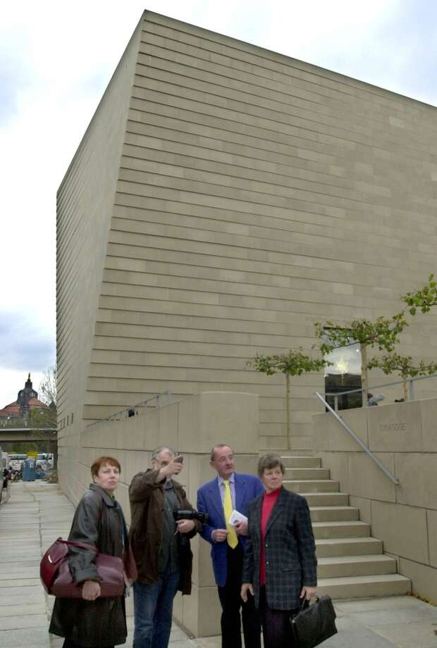 People stand in front of a new synagoge in Dresden, eastern Germany, Wednesday, Nov. 7, 2001, 63 years after the Nazis burned synagogues in Germany, in a rampage known as Kristallnacht.  It is the first new synagogue  built in eastern Germany after WW II. (AP Photo/Matthias Rietschel) Photo: MATTHIAS RIETSCHEL, AP