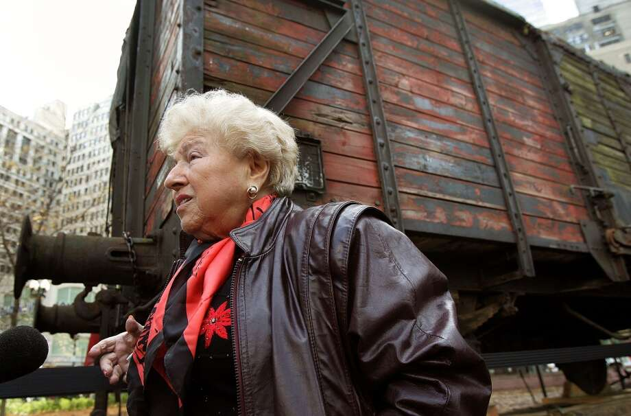 Holocaust survivor Barbara Steiner, from Skokie, Illinois speaks to the media in front of what is believed to be a German boxcar used during the Holocaust Nov. 9, 2005 in Chicago, Illinois. Steiner at the age of 16, was transported in a boxcar similar to this one to the Majdanek extermination camp in Poland. Steiner lost her parents and two brothers in the Holocaust. The boxcar unveiling was part of a program for the 57th anniversary of Kristallnacht and will be a cornerstone for a new Holocaust museum to be built in Skokie, Illinois. (Tim Boyle/Getty Images) Photo: Tim Boyle, Getty Images