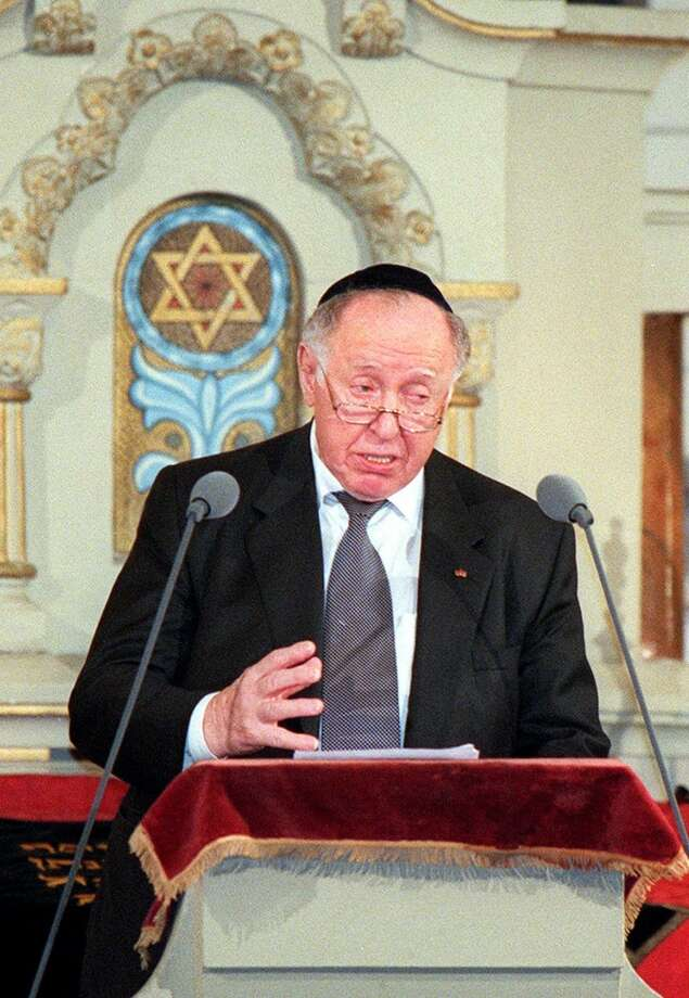 Ignatz Bubis, head of Germany's Jewish community, gestures during his speech to the participants of the commemoration on the 60th anniversary of the Kristallnacht pogrom (Night of Broken Glass), when Nazi storm troopers destroyed Jewish businesses and synagogues in Germany and Austria, in the Berlin synagogue Monday, Nov. 9, 1998. (AP Photo/Hans Edinger) Photo: HANS EDINGER, AP