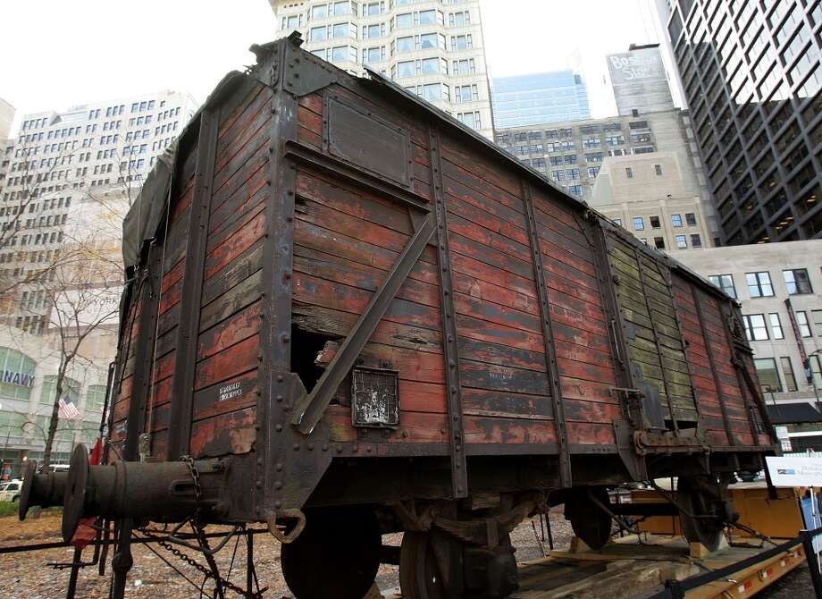 What is believed to be a German boxcar used during the Holocaust is displayed during its unveiling November 9, 2005 in downtown Chicago, Illinois. The boxcar unveiling was part of a program for the 57th anniversary of Kristallnacht and will be a cornerstone for a new Holocaust museum to be built in Skokie, Illinois. (Photo by Tim Boyle/Getty Images) Photo: Tim Boyle, Getty Images