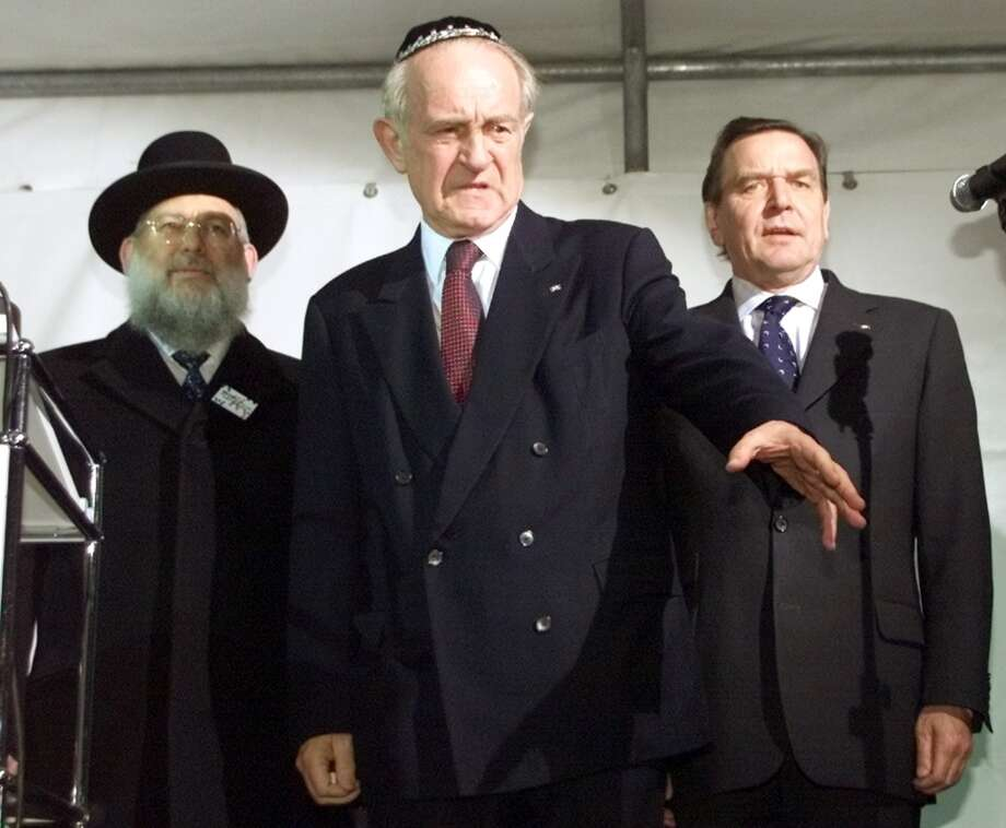 German President Johannes Rau, center, is flanked by Rabbi Ehrenberg,  the leader of Germany's Jewish community and German Chancellor Gerhard Schroeder, right during a protest against hate and anti-foreigner violence in Berlin, Thursday, Nov. 9, 2000 on the anniversary of the Nazis' infamous 1938 Kristallnacht anti-Jewish pogrom, also known as the 'Night of Broken Glass.' (AP Photo/Herbert Knosowski) Photo: HERBERT KNOSOWSKI, AP