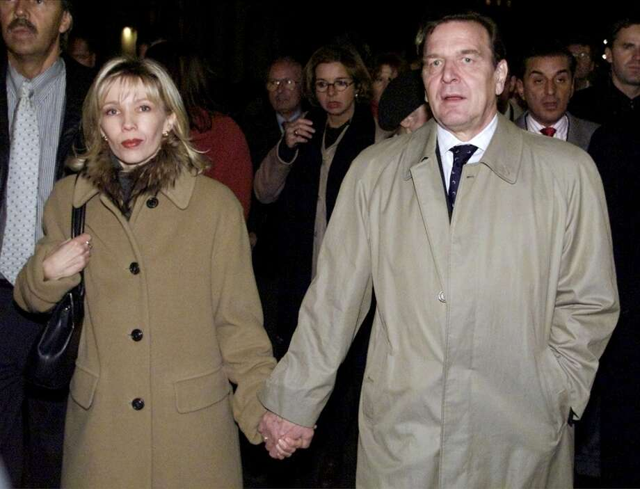 German Chancellor Gerhard Schroeder, right, and his wife Doris Schroeder-Koepf, hold hands as they march during a protest against hate and anti-foreigner violence in Berlin, Thursday, Nov. 9, 2000 to commemorate the Nazis' infamous 1938 Kristallnacht anti-Jewish pogrom, also known as the 'Night of Broken Glass.'  . Michel Friedmann of the board of Germany's Jewish community is seen in the backgound, right. (AP Photo/Wolfram Steinberg) Photo: WOLFRAM STEINBERG, AP
