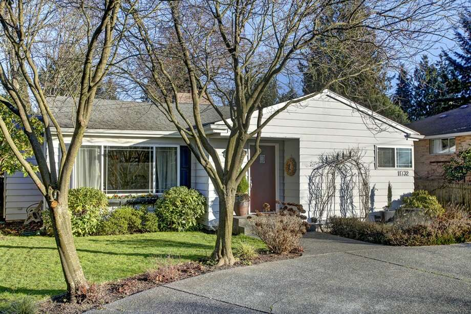 We'll start with the lowest priced home, 11732 Sand Point Way N.E., which is listed for $449,950. The 1,780-square-foot house, built in 1963, has four bedrooms, 2.5 bathrooms and a patio on a 7,733-square-foot lot. Photo: Courtesy Kelli Howison,  Redfin