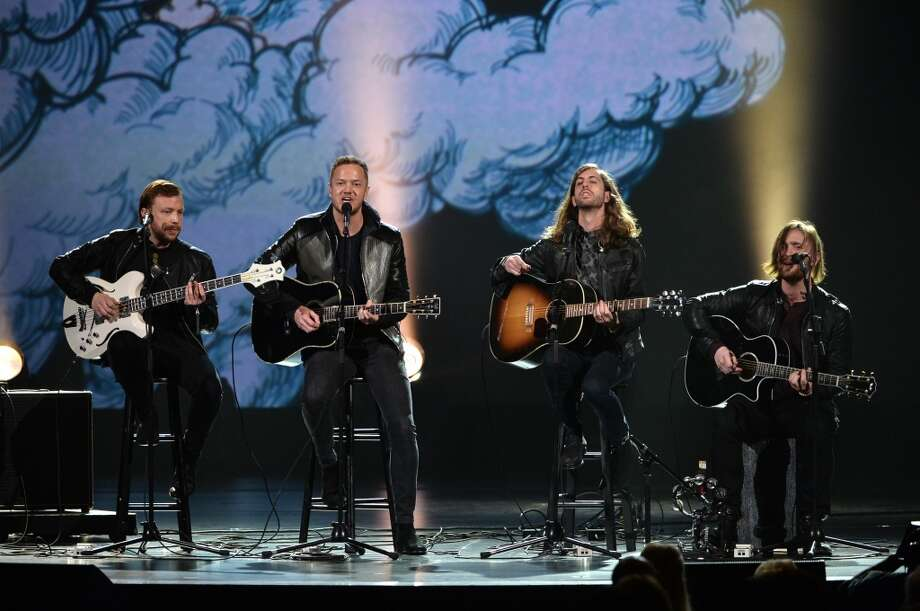 "L-R) Recording artists Ben McKee, Dan Reynolds, Wayne Sermon and Daniel Platzman of Imagine Dragons perform onstage during ""The Night That Changed America: A GRAMMY Salute To The Beatles"" at the Los Angeles Convention Center on January 27, 2014 in Los Angeles, California. Photo: Kevin Winter, Getty Images For NARAS"