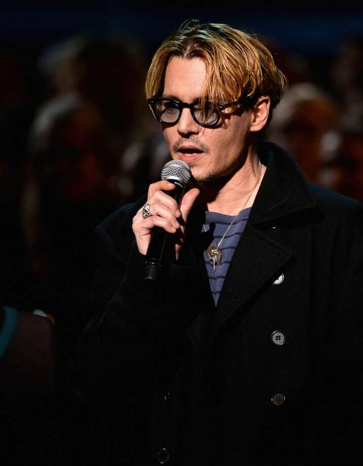 "Actor Johnny Depp speaks onstage during ""The Night That Changed America: A GRAMMY Salute To The Beatles"" at the Los Angeles Convention Center on January 27, 2014 in Los Angeles, California. Photo: Kevin Winter, Getty Images"