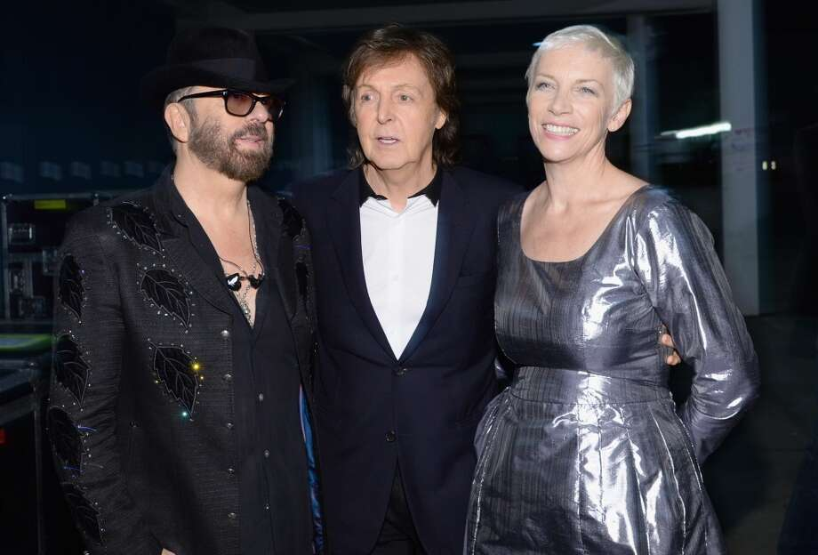"Recording artists David A. Stewart of the Eurythmics, recording artist Paul McCartney and Annie Lennox of the Eurythmics pose backstage at ""The Night That Changed America: A GRAMMY Salute To The Beatles"" at the Los Angeles Convention Center on January 27, 2014 in Los Angeles, California. Photo: Larry Busacca, Getty Images For NARAS"