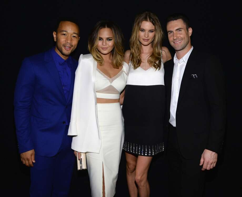 "(L-R) Recording artist John Legend, model Christine Teigen, model Behati Prinsloo and recording artist Adam Levine of Maroon 5 attend ""The Night That Changed America: A GRAMMY Salute To The Beatles"" at the Los Angeles Convention Center on January 27, 2014 in Los Angeles, California. Photo: Larry Busacca, Getty Images For NARAS"