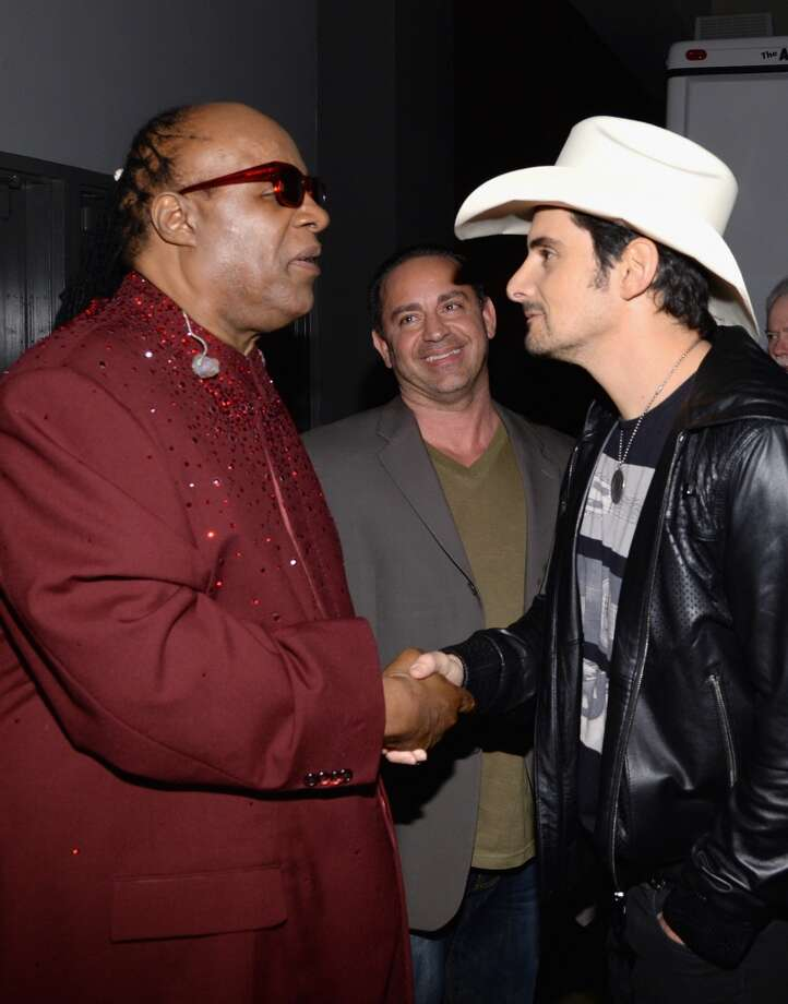 "(L-R) Recording artist Stevie Wonder and recording artist Brad Paisley pose backstage at ""The Night That Changed America: A GRAMMY Salute To The Beatles"" at the Los Angeles Convention Center on January 27, 2014 in Los Angeles, California. Photo: Larry Busacca, Getty Images For NARAS"