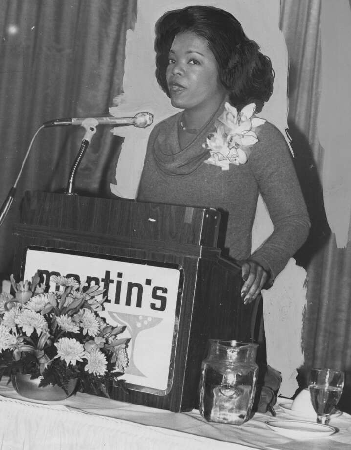 Oprah Winfrey speaks at a podium early in her career, during her time at WJZ, Baltimore, Maryland, 1978 . Photo: Afro Newspaper/Gado, Getty Images