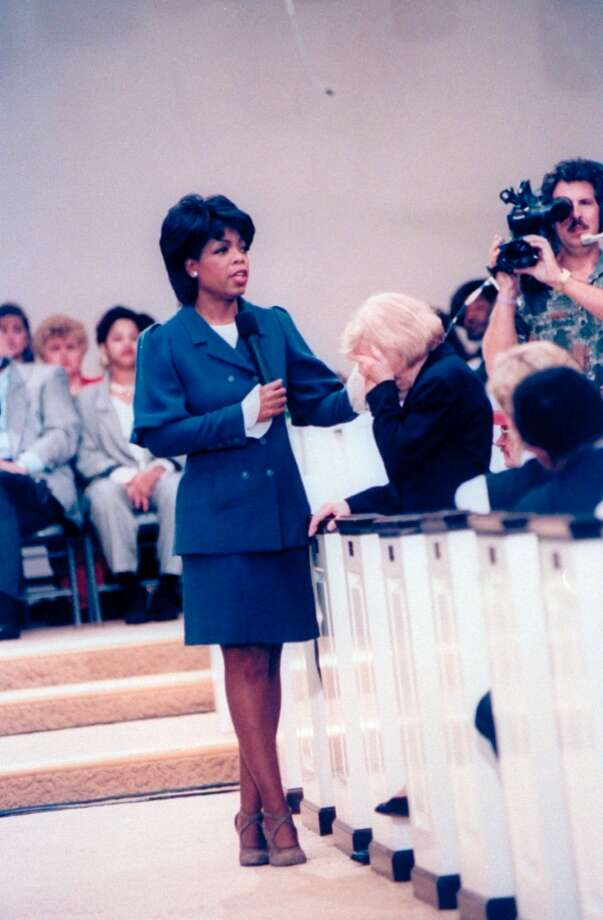 TV talk show host Oprah Winfrey consoling a distraught mourner during a segment of 'The Oprah Winfrey Show,' 1994. Photo: Taro Yamasaki, Time & Life Pictures/Getty Image