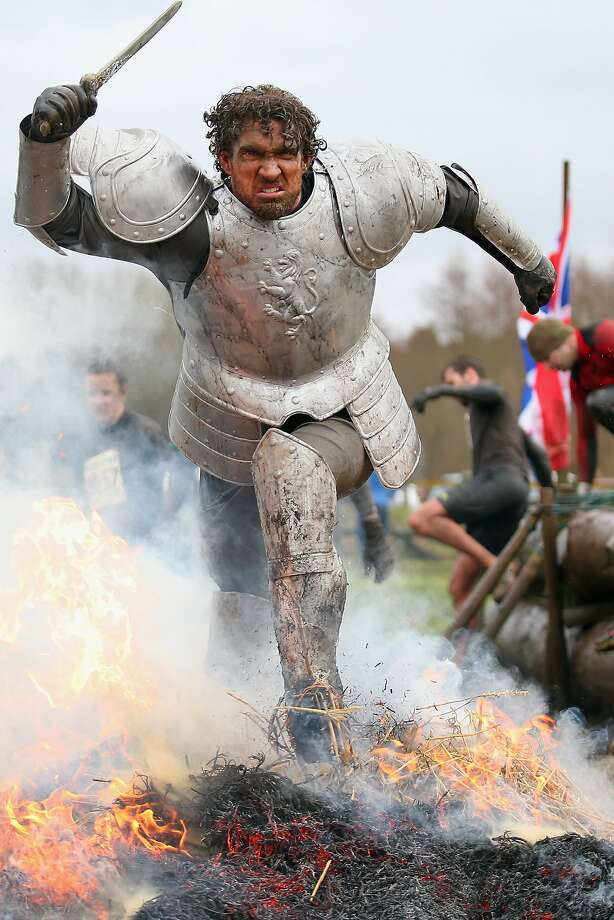 Showing off his metal: A knight runs through fire during the Tough Guy Challenge in Telford, England. Photo: Bryn Lennon, Getty Images