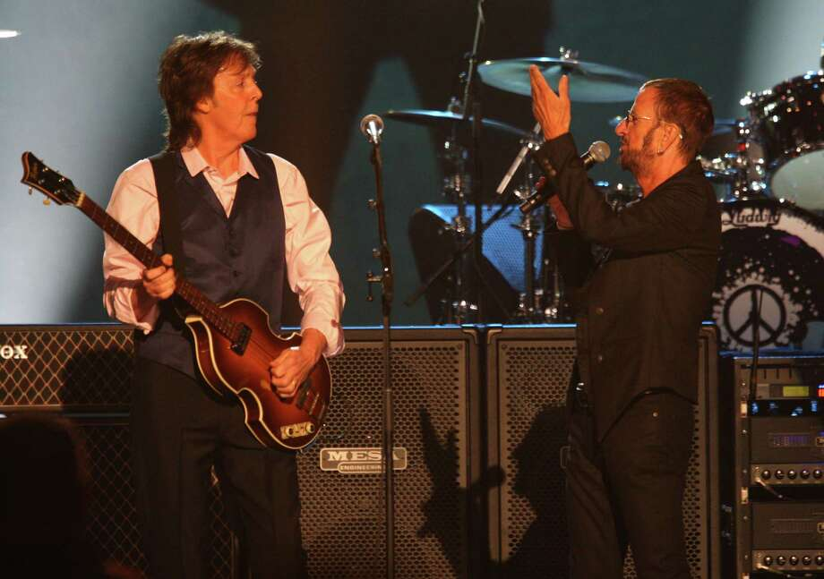 Paul McCartney and Ringo Starr perform at The Night that Changed America: A Grammy Salute to the Beatles, on Monday, Jan. 27, 2014, in Los Angeles. (Photo by Zach Cordner/Invision/AP) ORG XMIT: CAZC117 Photo: Zach Cordner / Invision
